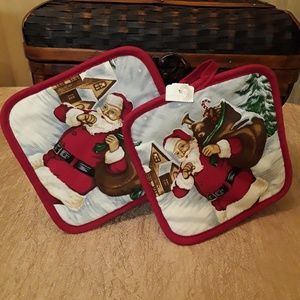 Pair of Santa Delivering Gifts Potholders
